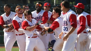Wade Kirkland is mobbed by his teammates following his walk-off home run in the bottom of the 17th inning